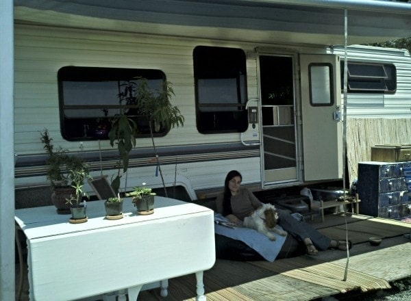 Erin and Charlie on our DIY deck in front of the trailer